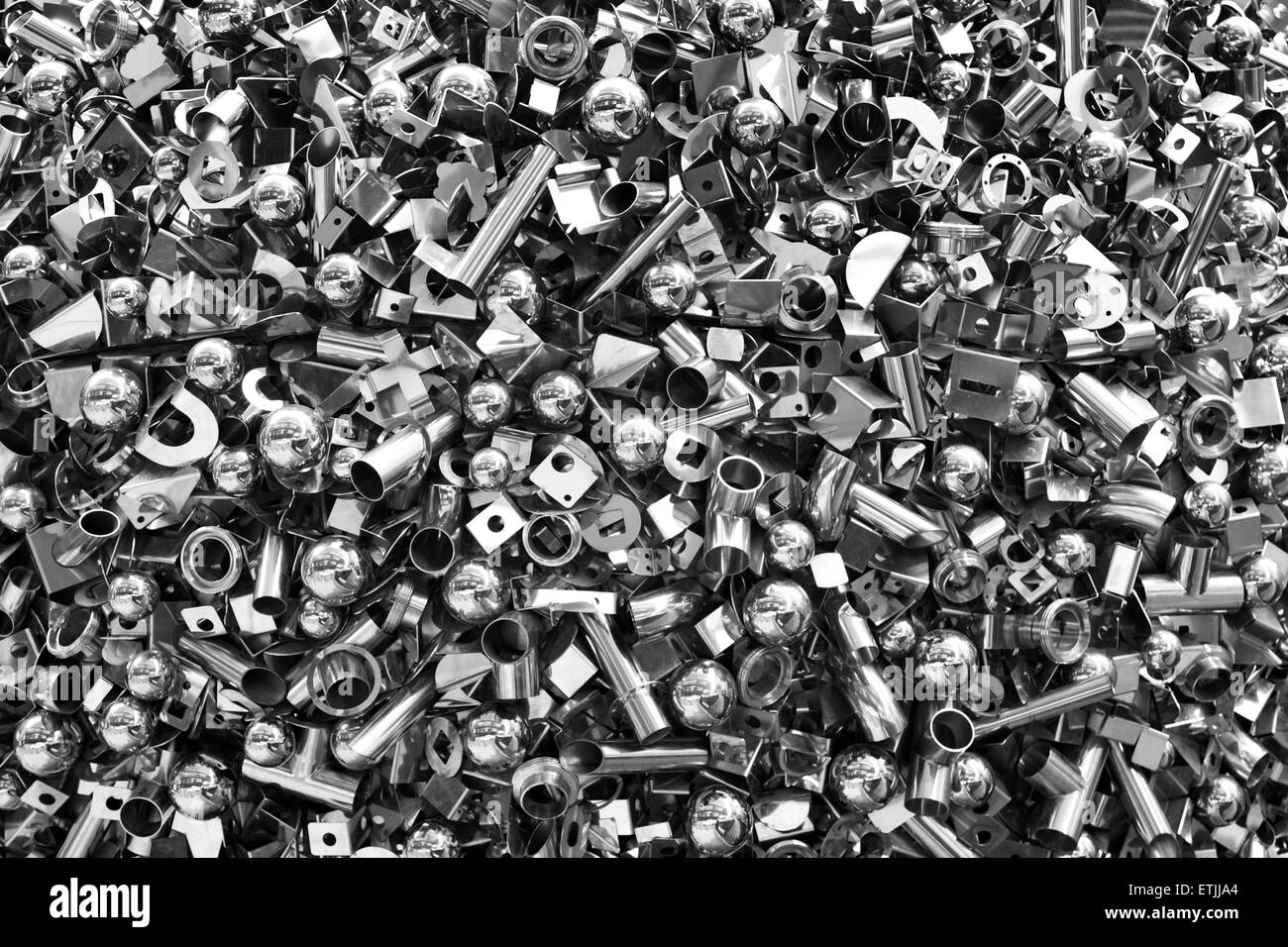 Detail from a sculptural piece made up of nuts, bots and screws, on display outside 30 St. Mary Axe, London, England - Stock Image