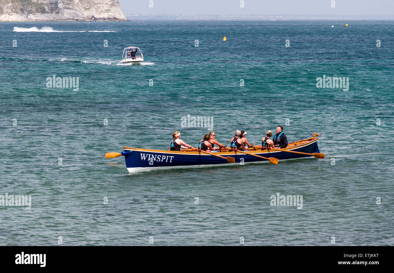 Cornish Pilot Gig, Winspit winning the sea rowing race. - Stock Image