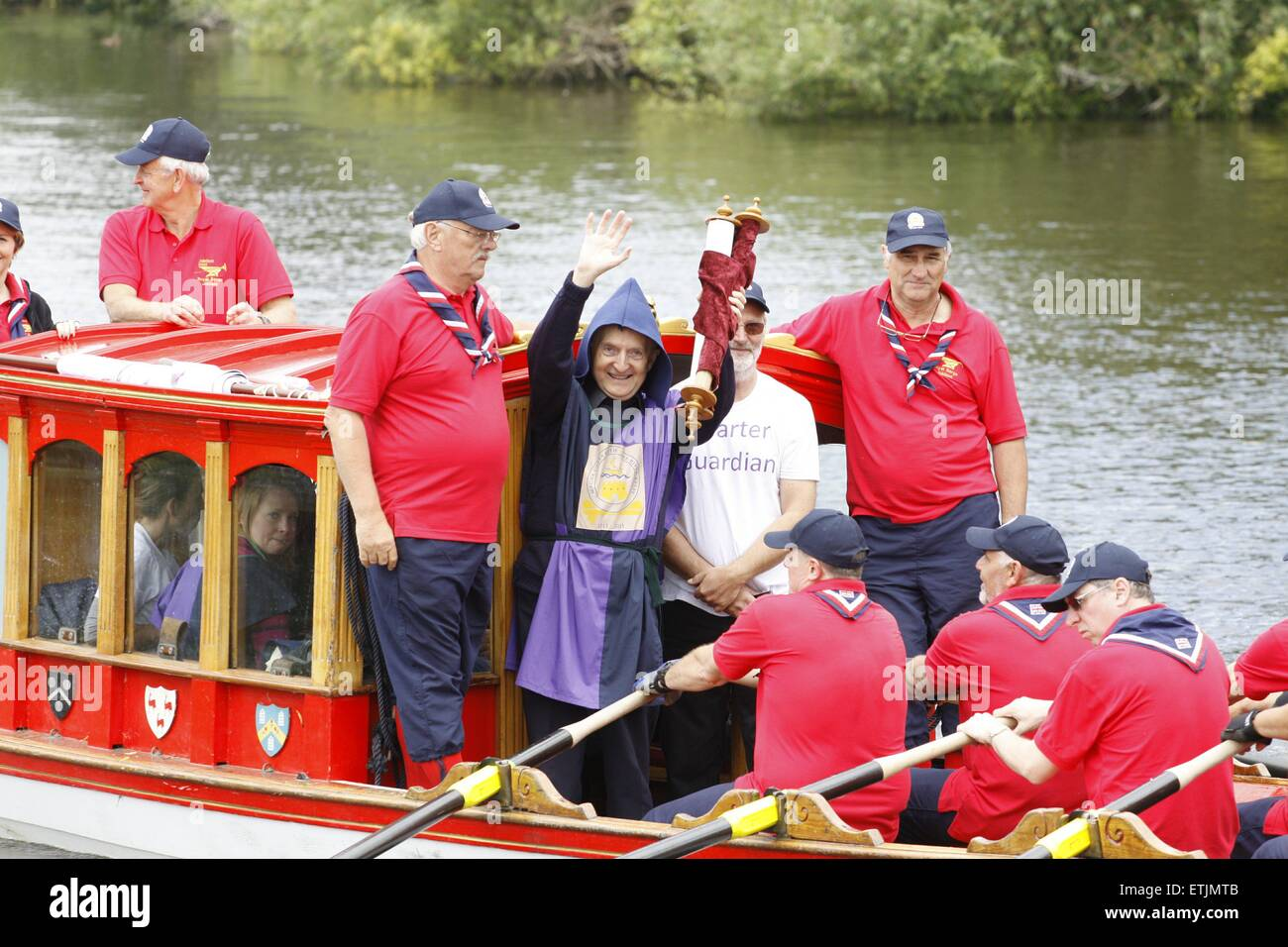 Windsor, Berkshire, UK. 14th June, 2015. A man holds aloft a replica of the magna carta.  A flotilla of boats headed - Stock Image