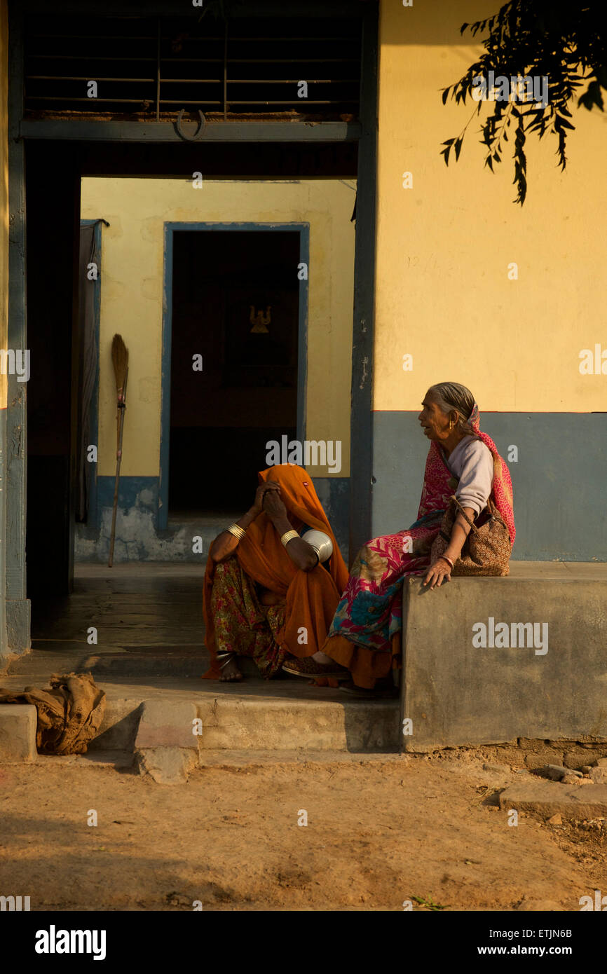 Indian women outside the doorwat to their home, Rakasthan, India - Stock Image