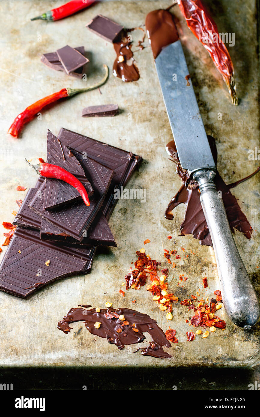 Chopping and melting dark chocolate with fresh and dry red hot chili ...