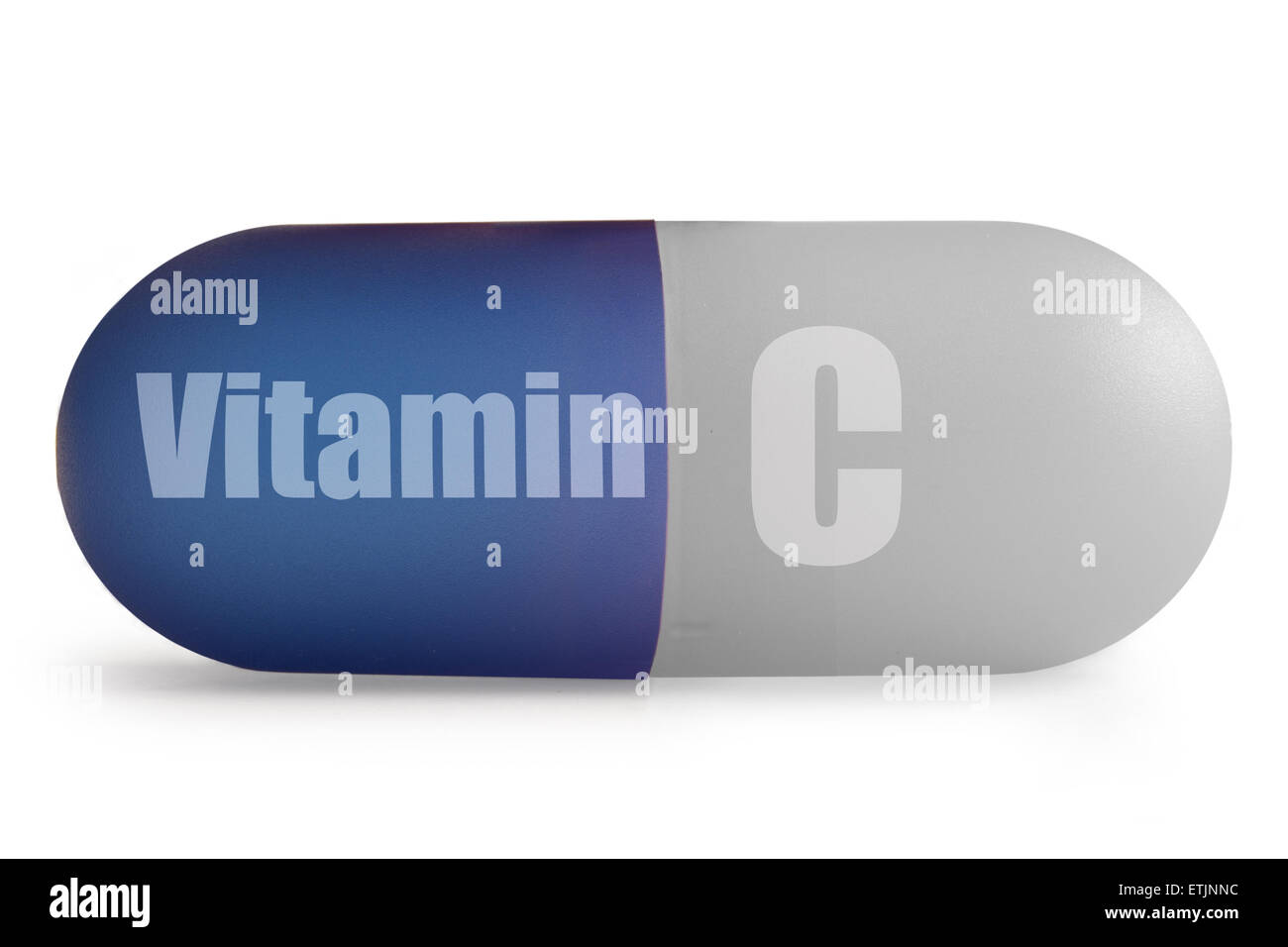 Close up of immunity enhancing vitamin c supplement pill over a white background - Stock Image