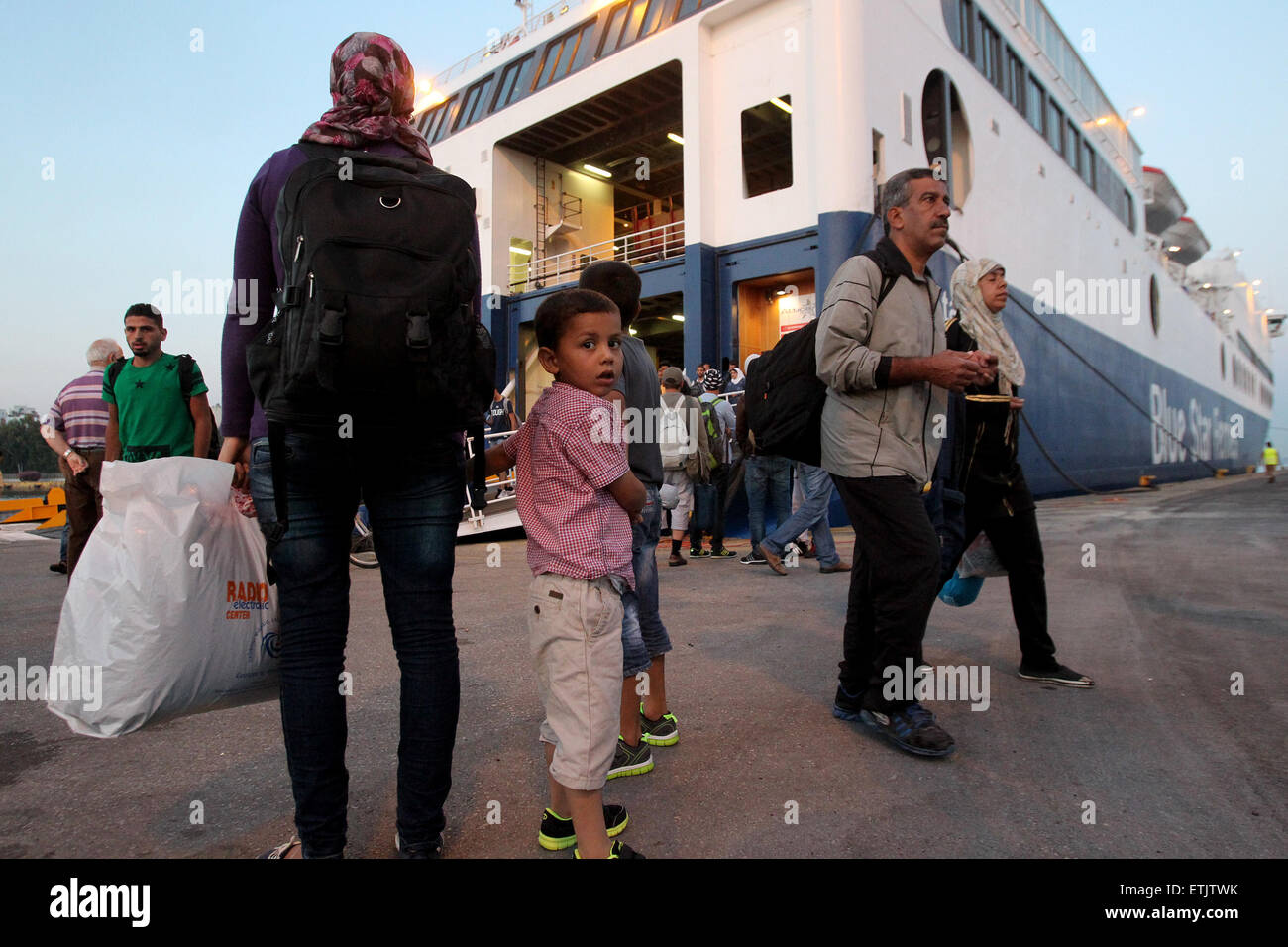 Athens, Greece. 14th June, 2015. Immigrants and refugees arrive at the port of Piraeus near Athens, Greece, June - Stock Image