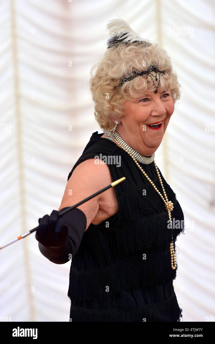 Old woman dancing to the Charleston holding her cigarette and holder - Stock Image
