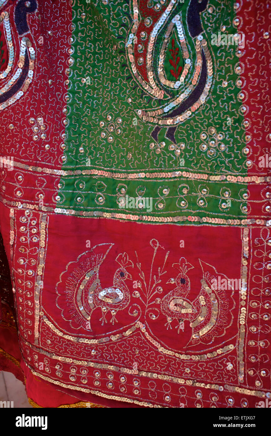 Indian textile with sequins and peacock motifs, Udaipur, Rajasthan, India - Stock Image