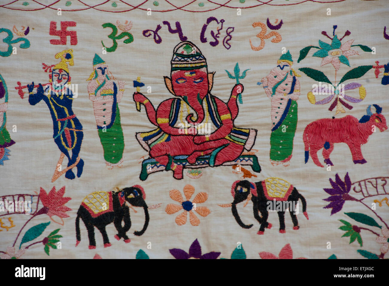 Embroidered textile depicting ganesh and elephants. Rajasthan, India - Stock Image
