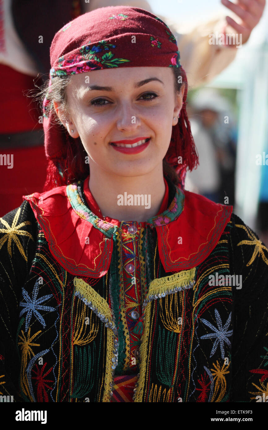 Young women in traditional costume at  Rose Festival Kazanlak Bulgaria Balkan Europe June  2015 - Stock Image