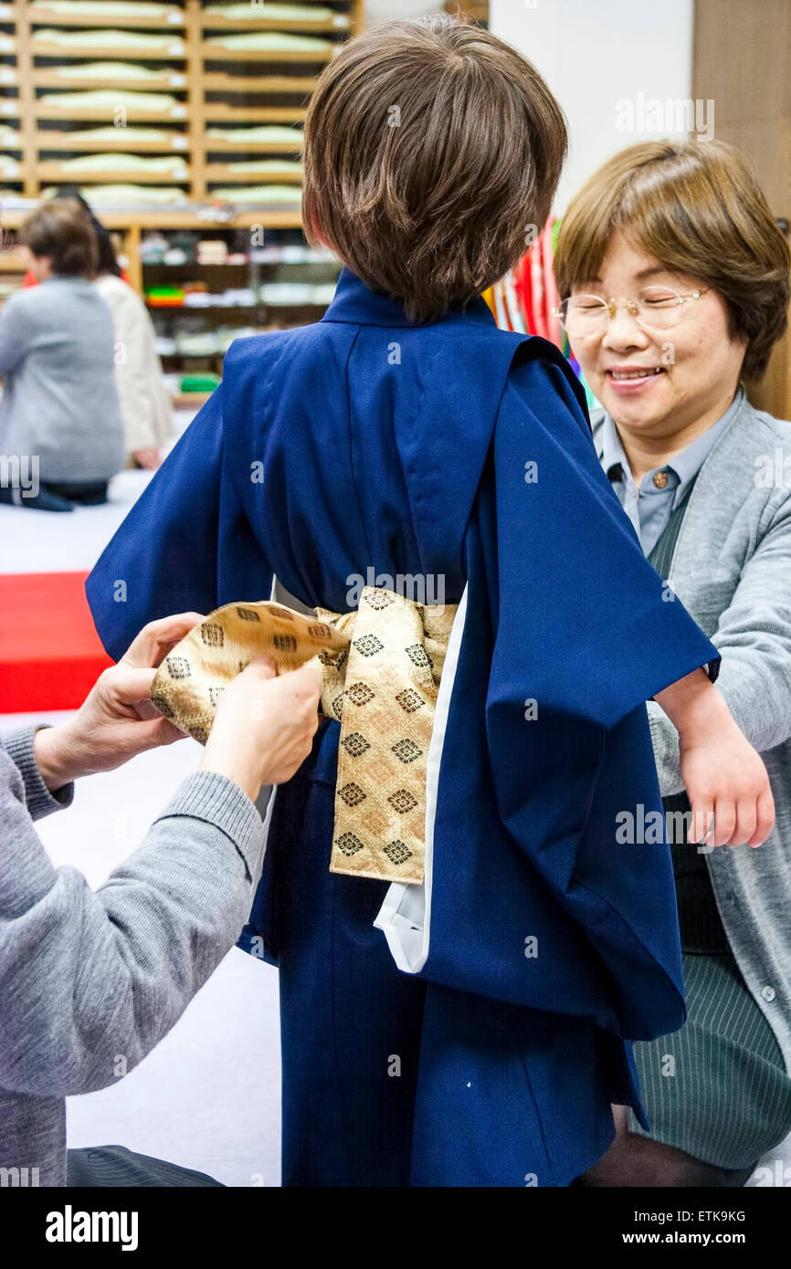 Interior With Two Japanese Mature Women Dressing Young Mixed Race