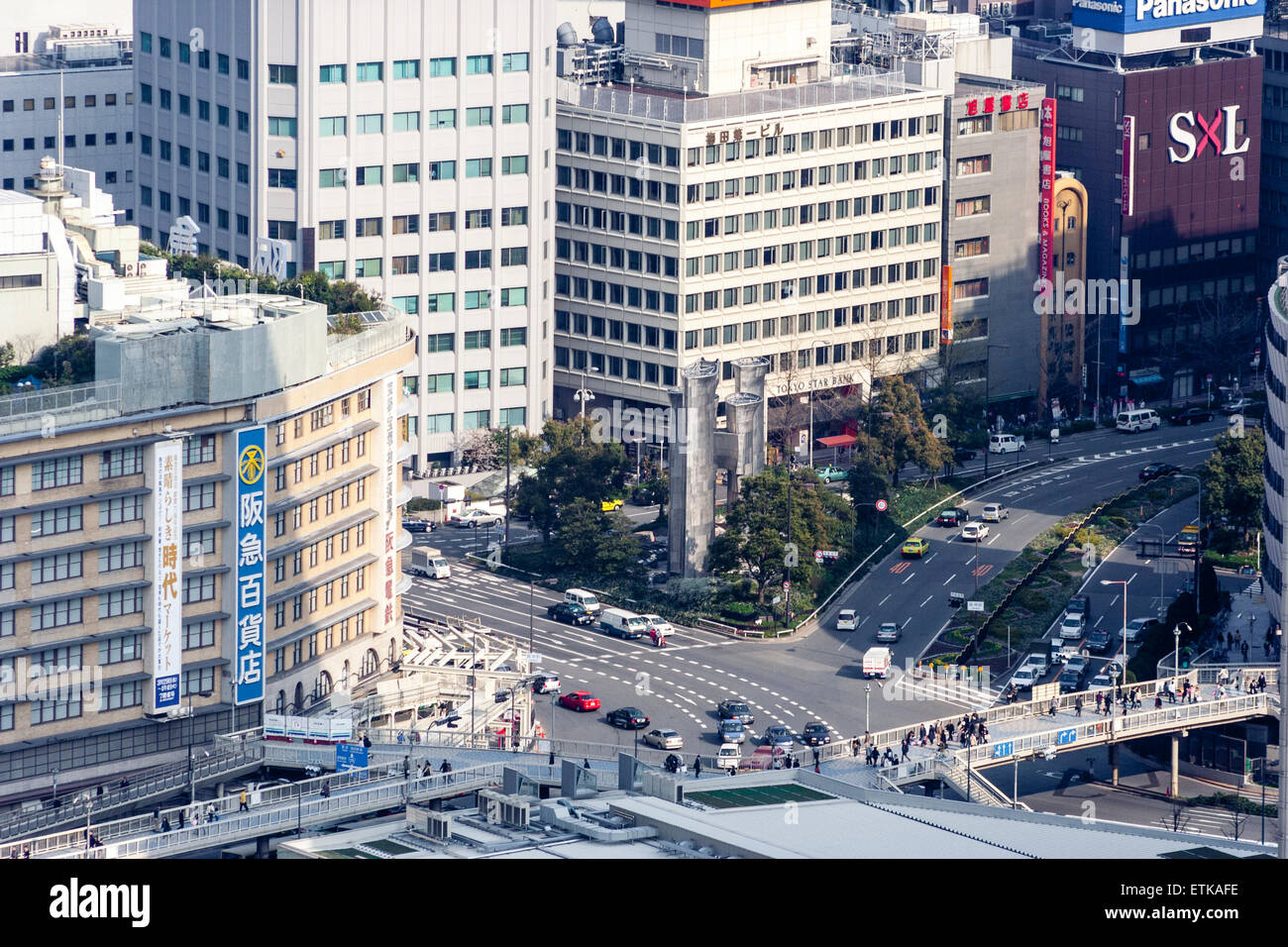 Japan, Osaka. Aerial view from Umeda Sky Building, Cityscape, road between two large department stores - Stock Image