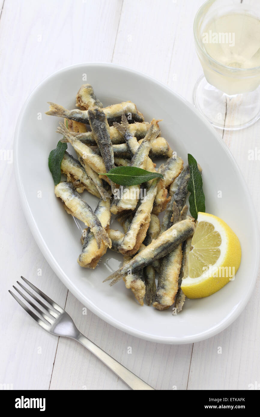 deep fried anchovies, boquerones fritos, acciughe fritte - Stock Image