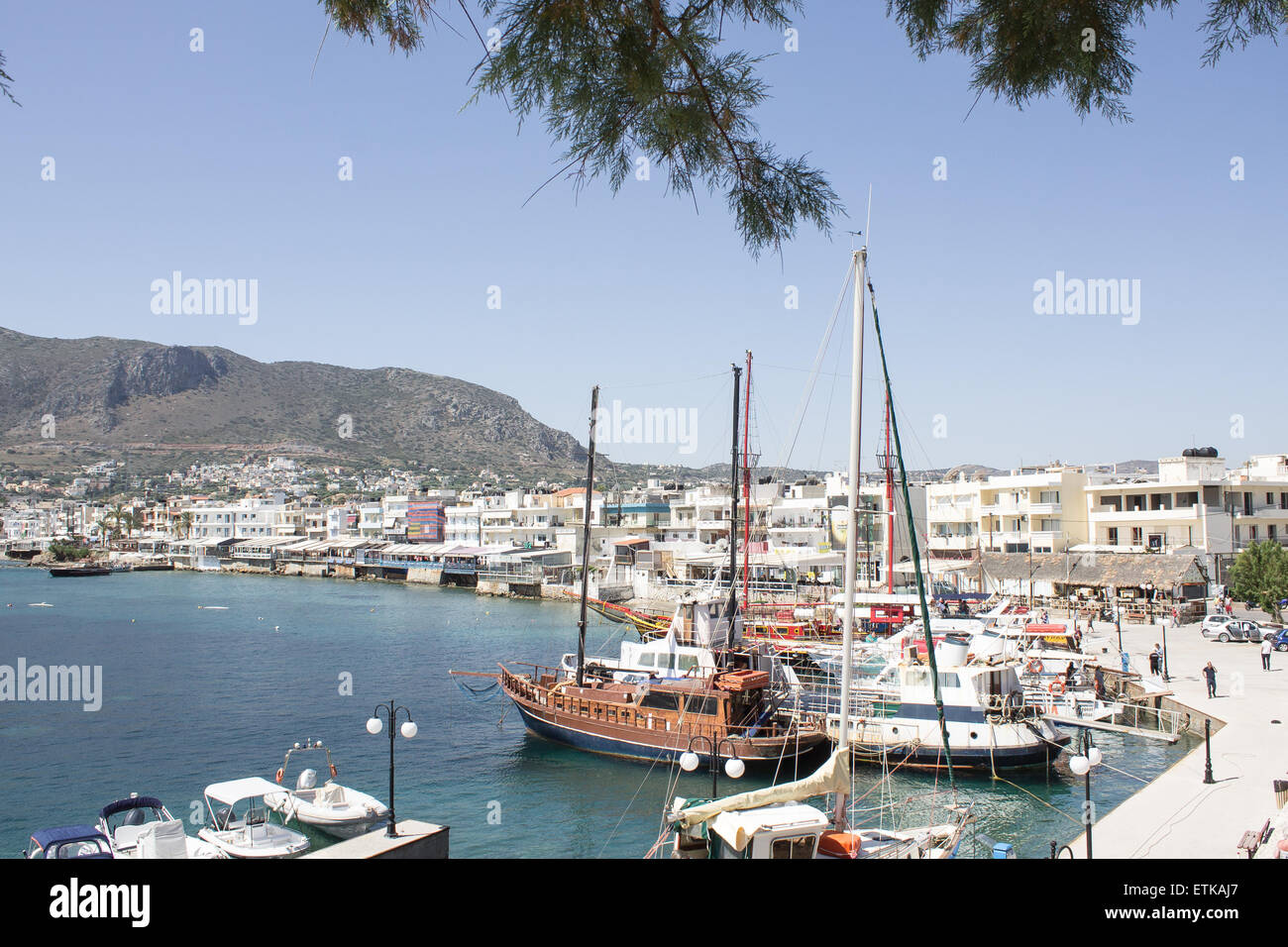 Boats lined up around the harbour in a popular tourist resort of Hersonissos in Crete. Stock Photo