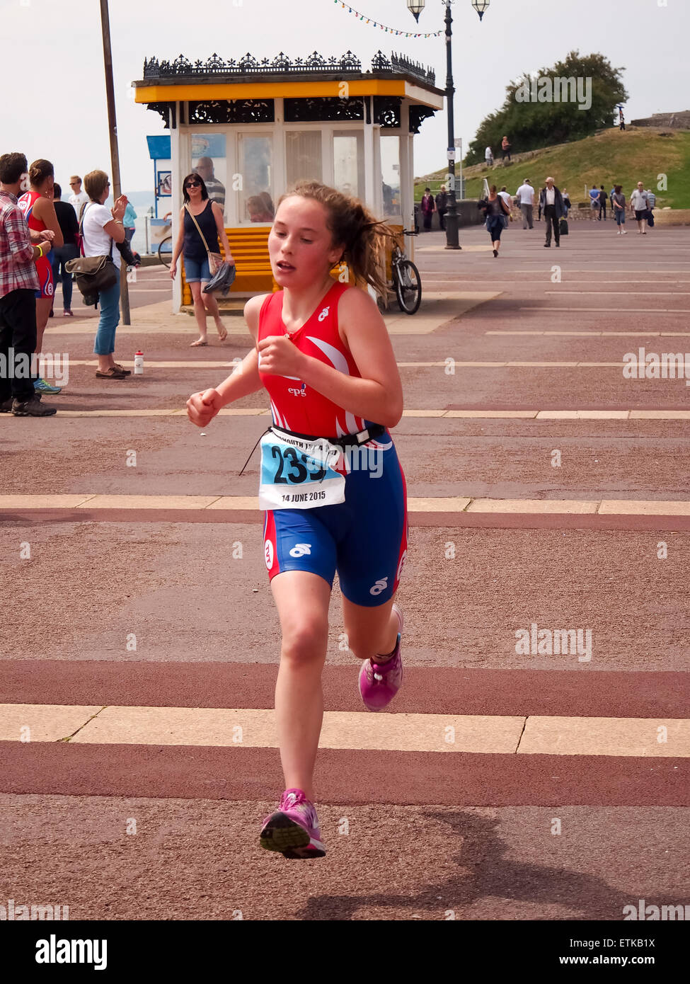 Portsmouth, UK. 14th June, 2015. A young athlete taking part in the the under 16 triathlon approaches the finish - Stock Image