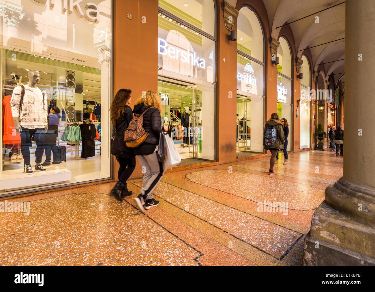 arcade outside Bershka clothing shop, Bologna, Italy - Stock Image