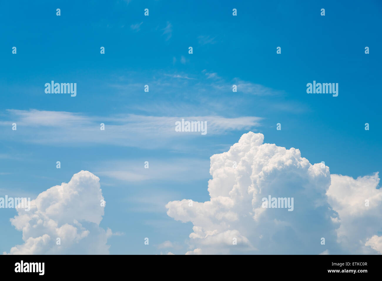 White Cumulonimbus Clouds On Summer Blue Sky - Stock Image