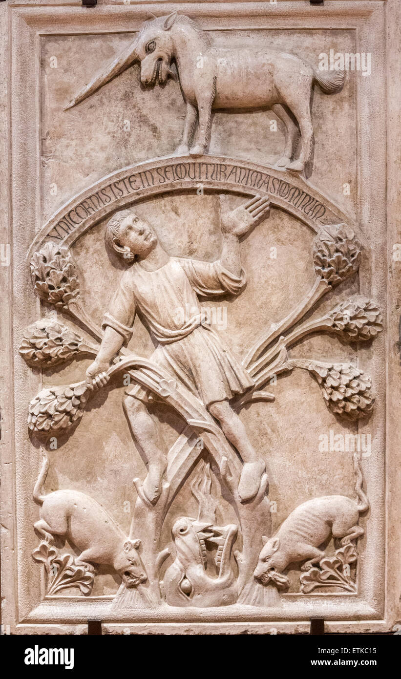 medieval sculpture of the fable of the unicorn (allegory of life), Ferrara Cathedral Museum, Ferrara, italy - Stock Image