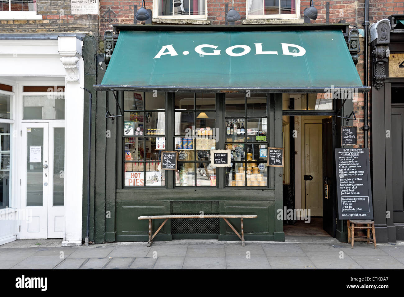 A. Gold traditional shop front Spitalfields, London Borough of Tower Hamlets, England, Britain UK - Stock Image