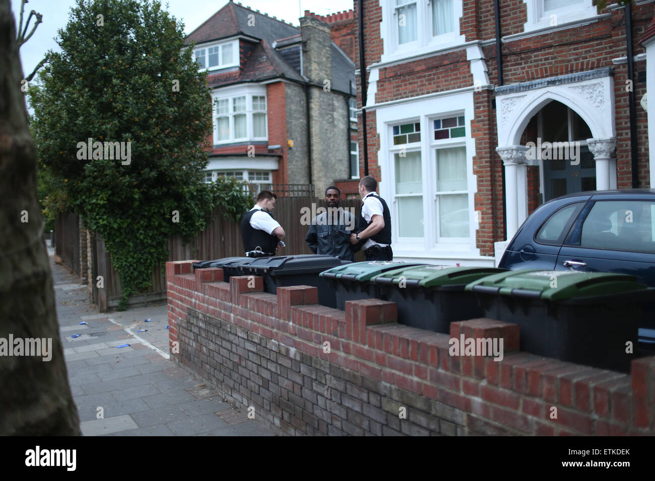 London, United Kingdom, 14 June 2015 - An unnamed male is held in cuffs by police following an alleged theft from - Stock Image