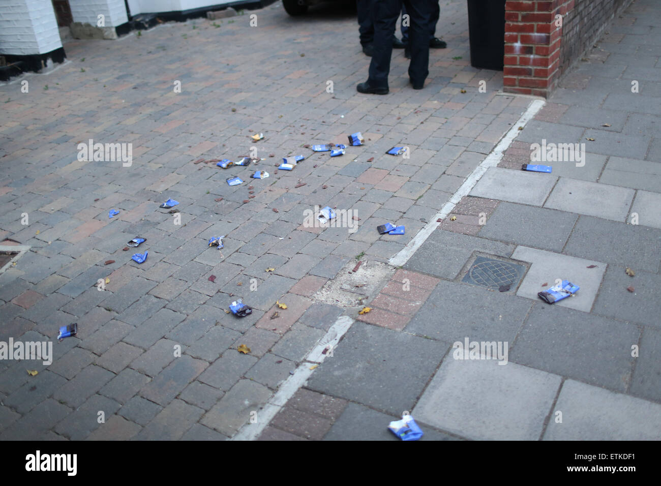 London, United Kingdom, 14 June 2015 - Smashed chocolate on the pavement following the arrest of a man after alleged - Stock Image