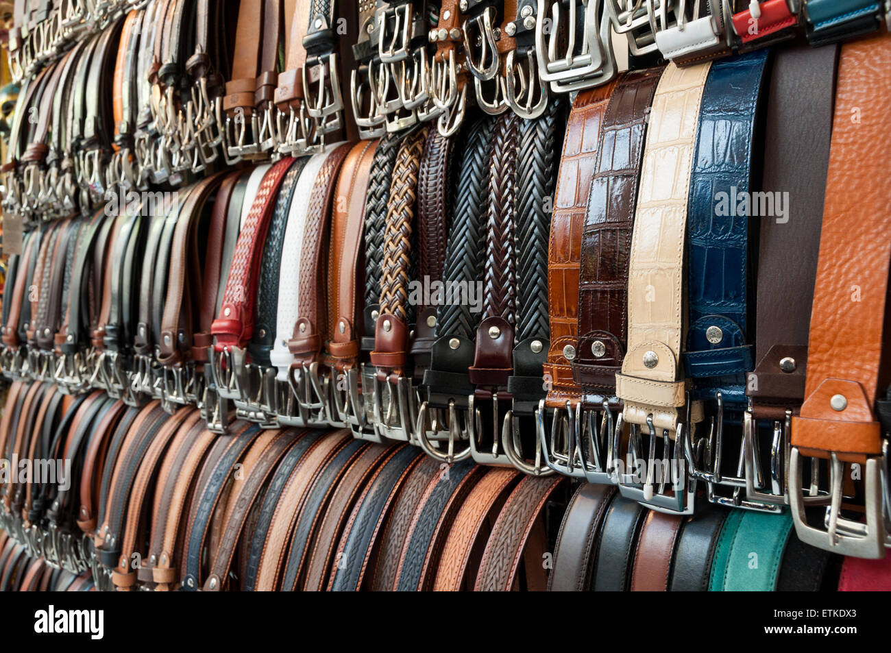 Belts seller in the Mercato Centrale in Florence, Italy - Stock Image