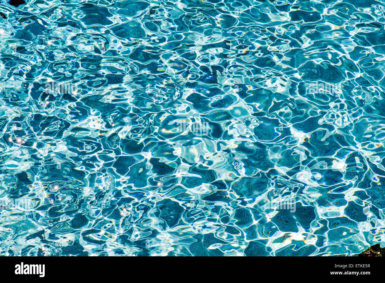 Sunlit reflections in the water of the 26,000 sq. ft. swimming pool, Kaua'i Marriott Resort; Kalapaki Bay, Kaua'i, - Stock Image