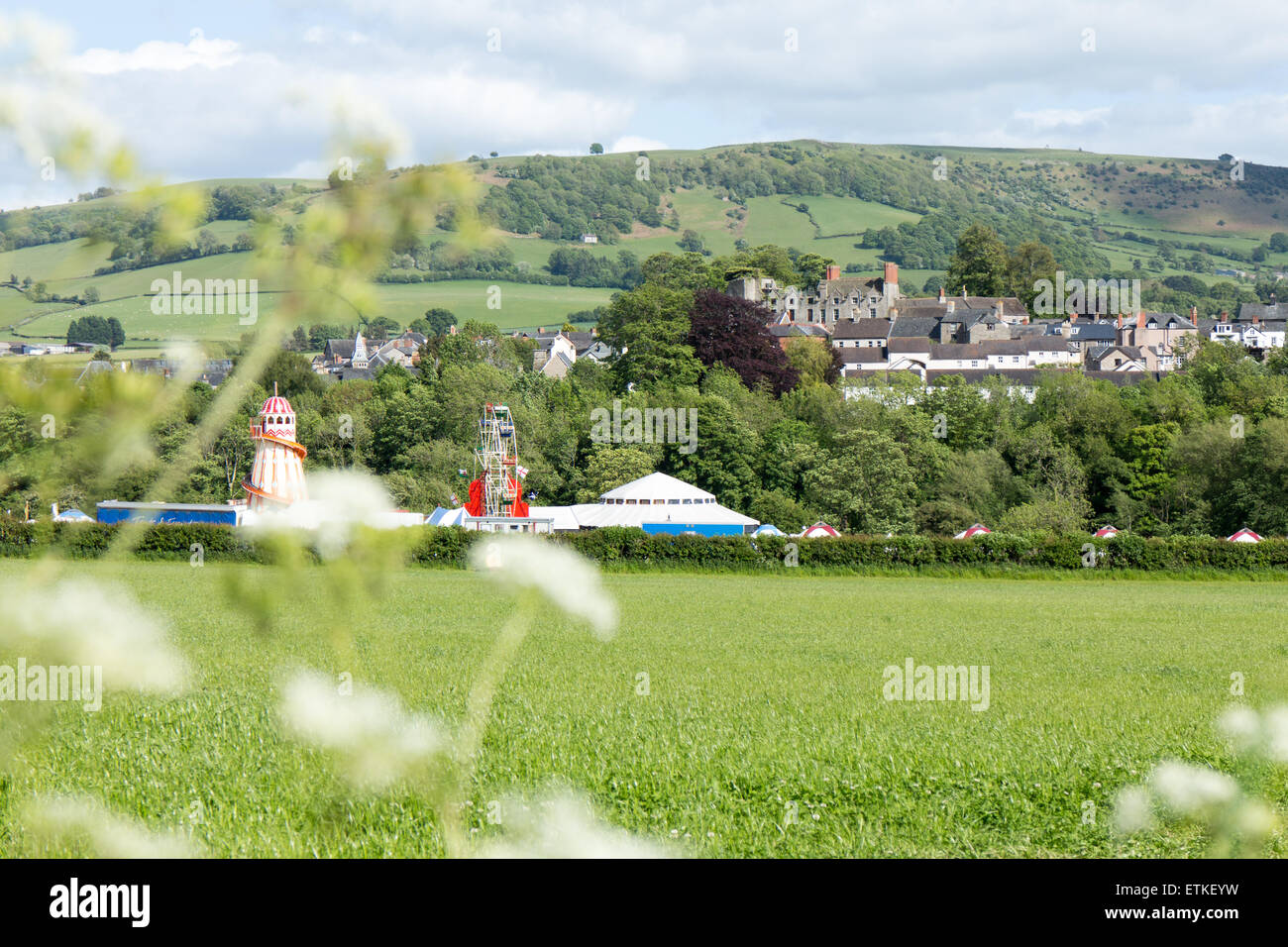 View across the 'How the Light Gets In' site, with fairground, to the town of Hay on Wye during Hay Festival - Stock Image