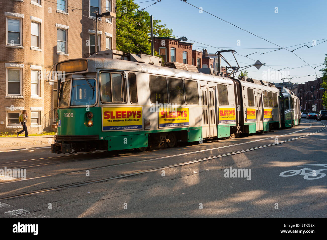An inbound train on the MBTA Huntington Avenue Line approaches Mission Park Station in Boston, Massachusetts. - Stock Image