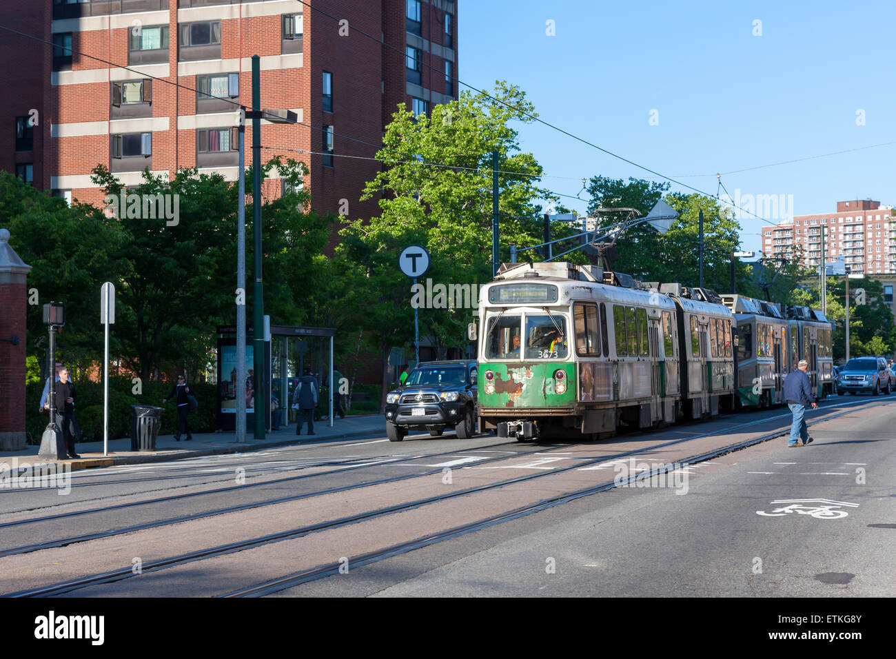A well-used outbound train on the MBTA Huntington Avenue Line approaches Mission Park Station in Boston, Massachusetts. - Stock Image