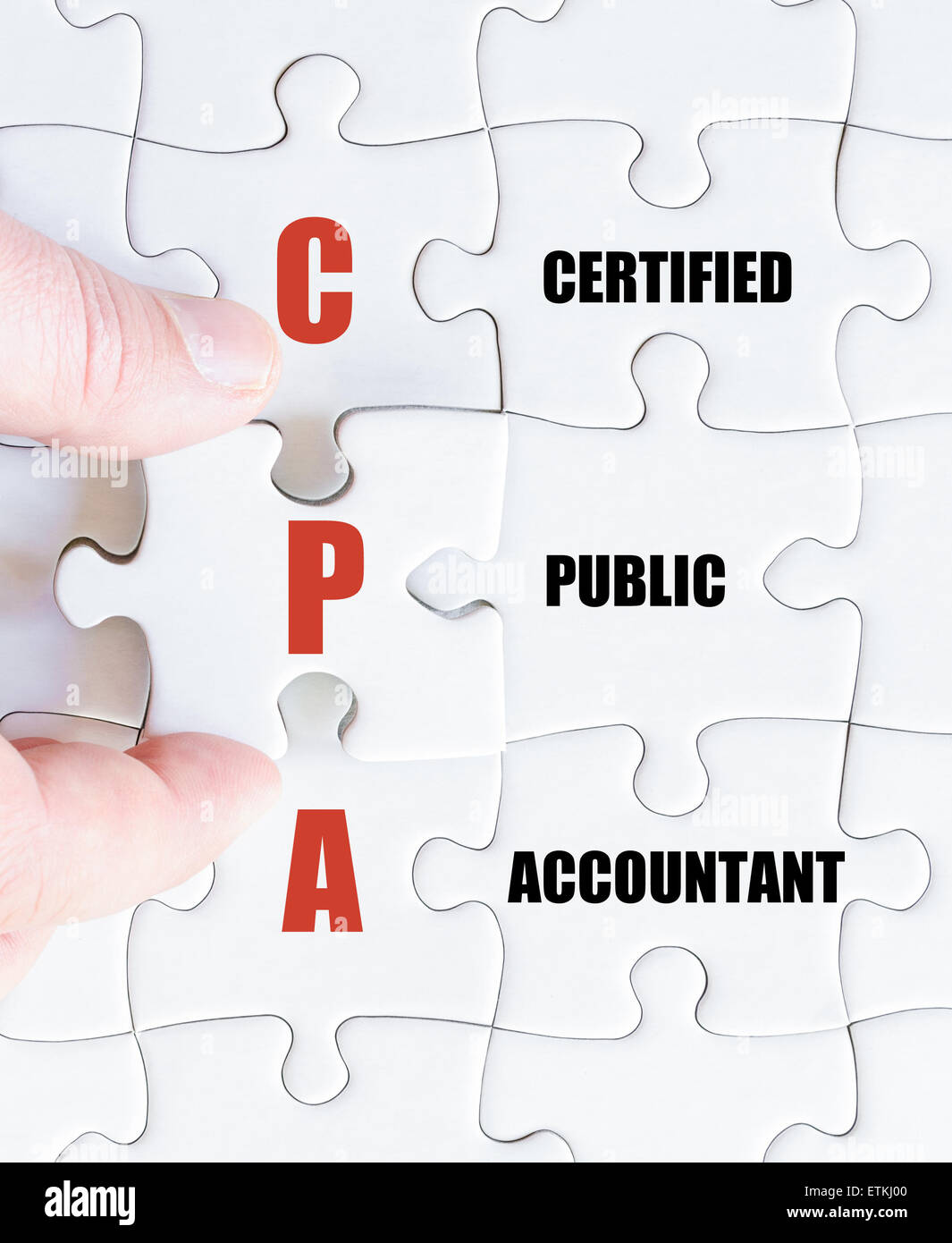 Hand of a business man completing the puzzle with the last missing piece.Concept image of Business Acronym CPA as - Stock Image