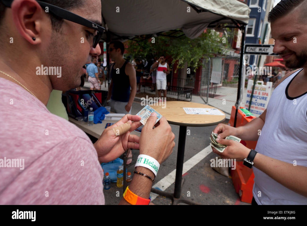 Bouncer checking ID at bar entrance - USA - Stock Image