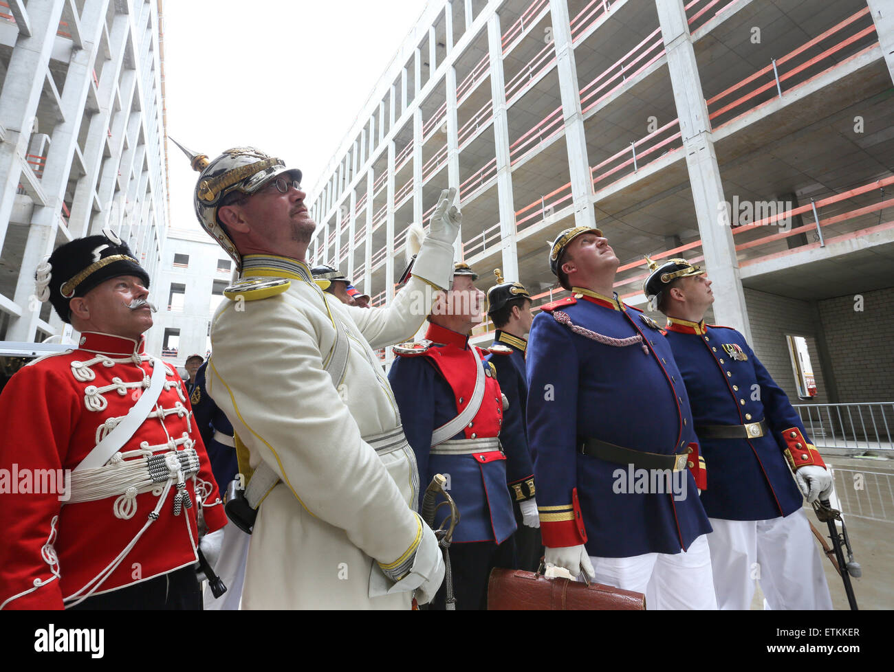 Berlin, Germany. 14th June, 2015. Members of a club wear uniforms of the former Prussian army as they visit the construction site of the Berlin City Palace in Berlin, Germany, 14 June 2015. The site was open to the public during the 'Open Construction Site Day' for two days. PHOTO: STEPHANIE PILICK/dpa/Alamy Live News Stock Photo