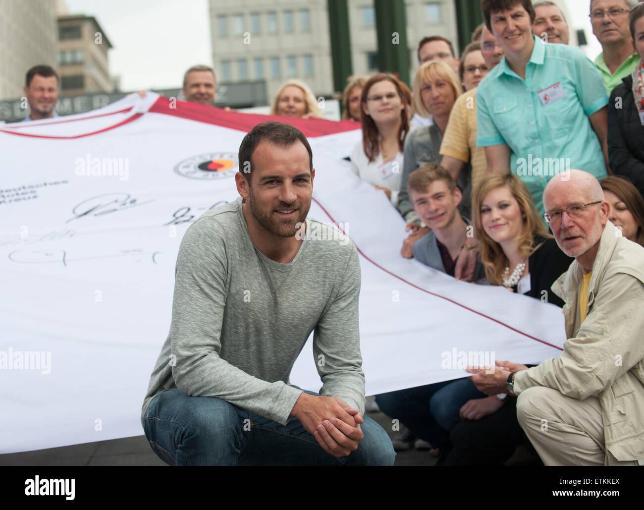 Berlin, Germany. 14th June, 2015. Former German national soccer team player Christoph Metzelder (C) poses with blood - Stock Image