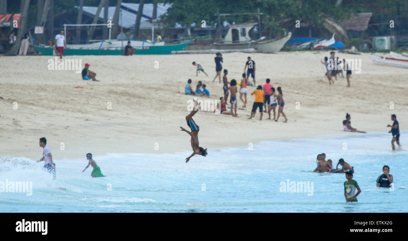 Philippines. 14th June, 2015. Beach goers enjoying at Dahican Beach. Dahican Beach, is a white sand, crescent-shaped, - Stock Image
