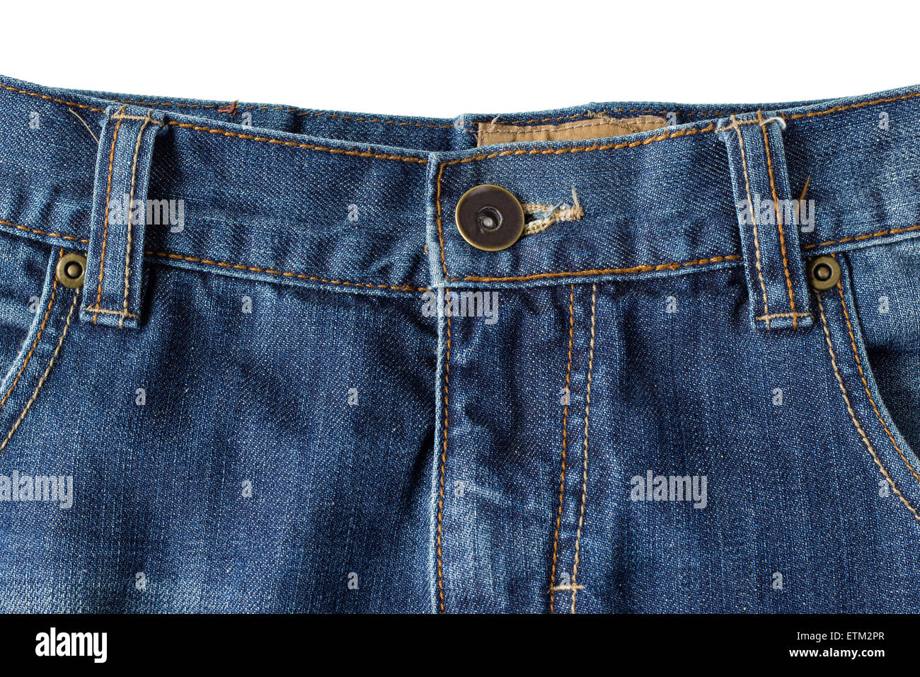 Close-up of buttoned blue denim jeans isolated on white background - Stock Image