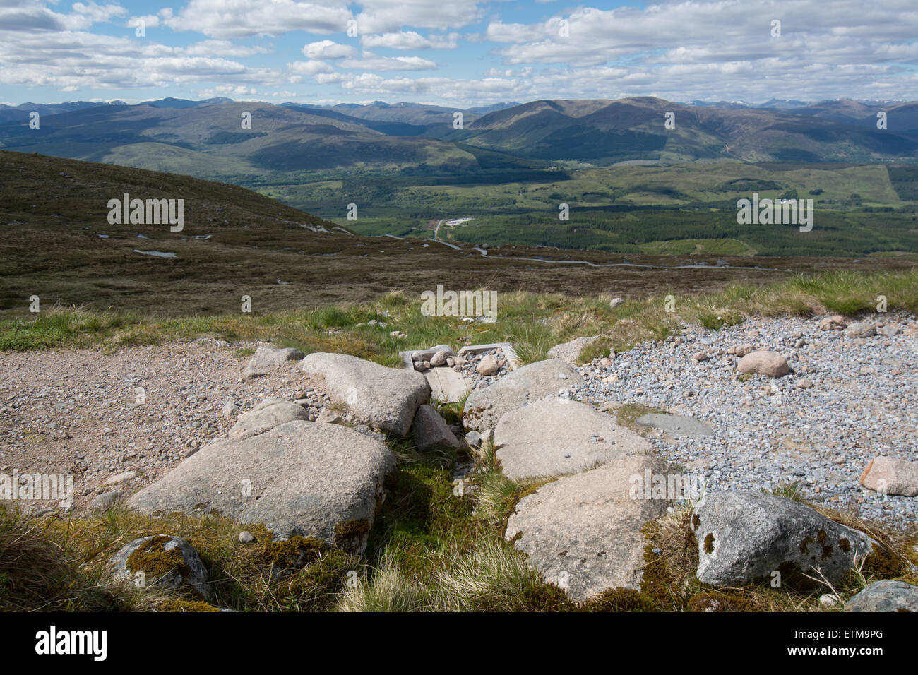 Upland path drainage technique - Stone Cross-drain on footpath on Aonach Mor, Fort William, Scotland, UK - Stock Image