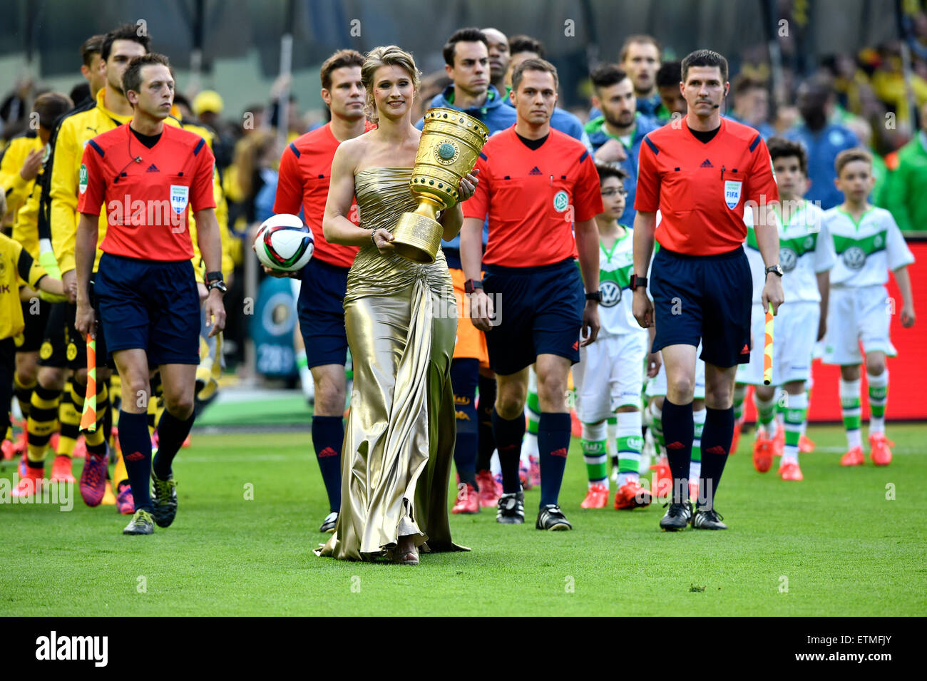 DFB Cup final 2015, Britta Heidemann bringing trophy into stadium, referees and teams behind, Olympic Stadium, Berlin, - Stock Image