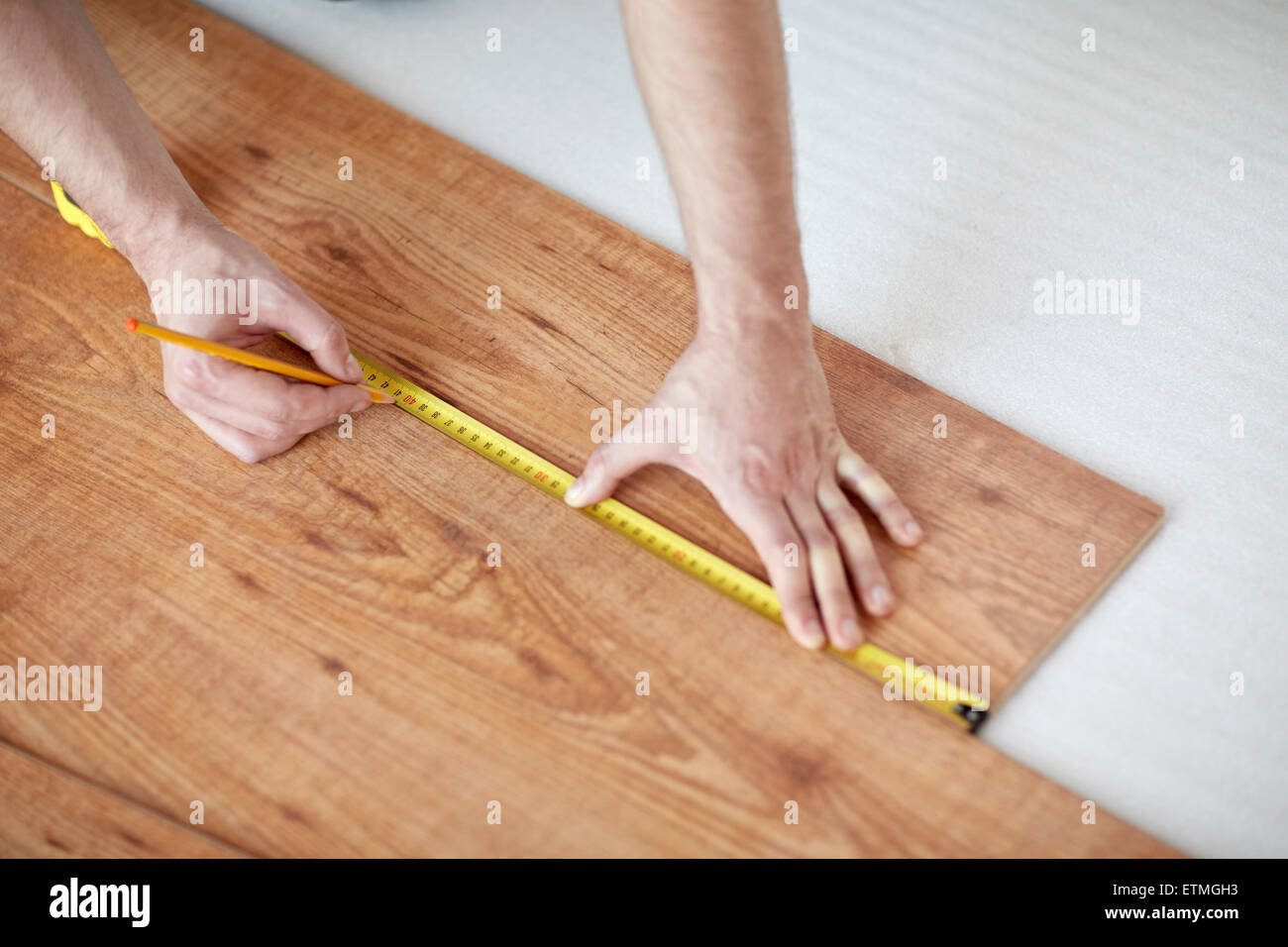Close Up Of Male Hands Measuring Flooring Stock Image