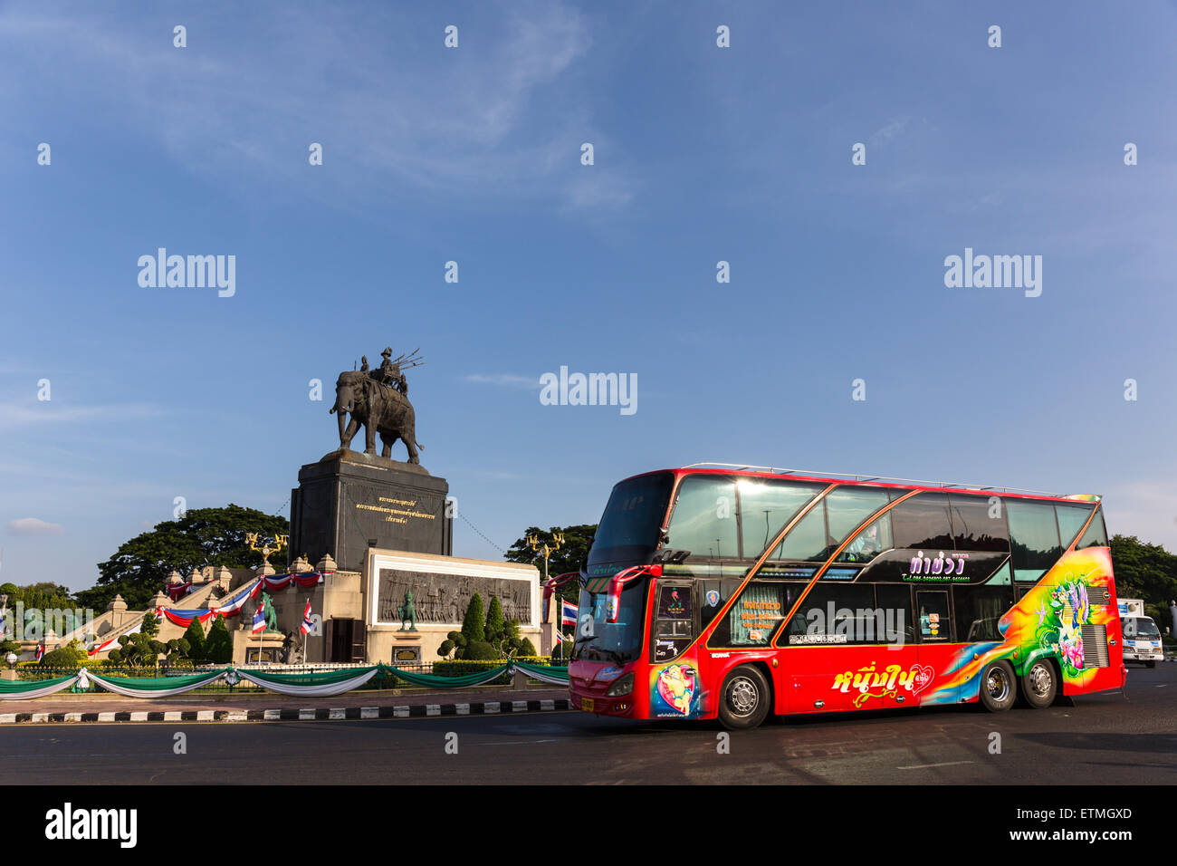 King Rama I Monument, elephant, red bus in the roundabout, Buri Ram, Buriram Province, Isan, Isaan, Thailand - Stock Image