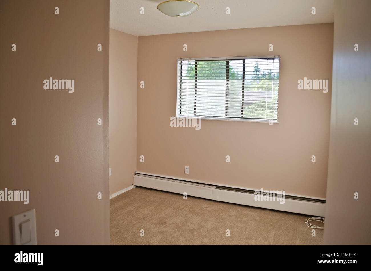 Small Empty Bedroom In A Low Rise Apartment Building In Greater