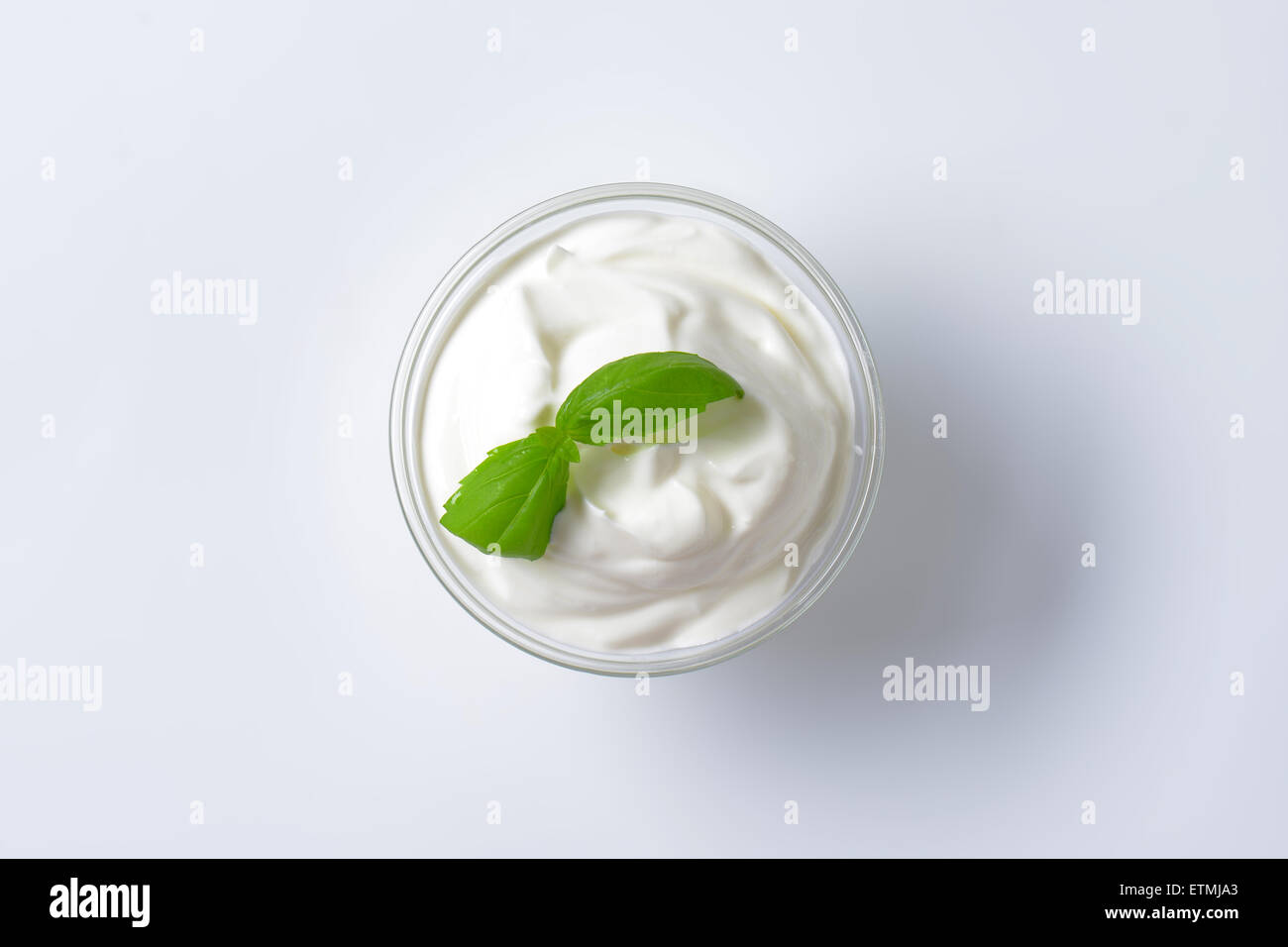 fromage blanc in a glass bowl - Stock Image
