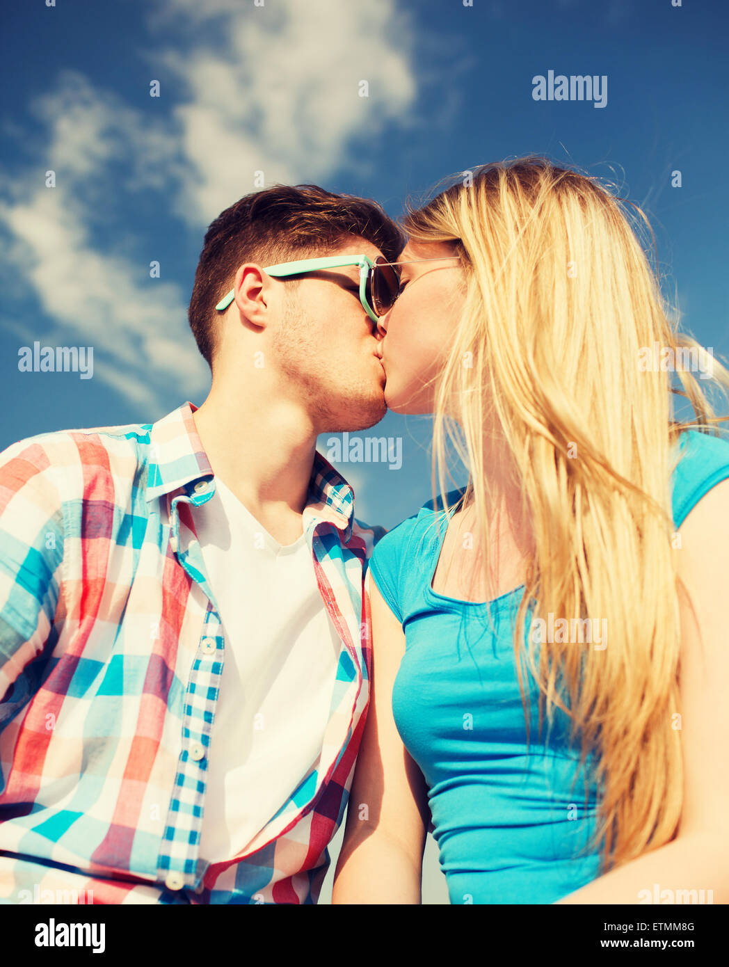 smiling couple outdoors - Stock Image