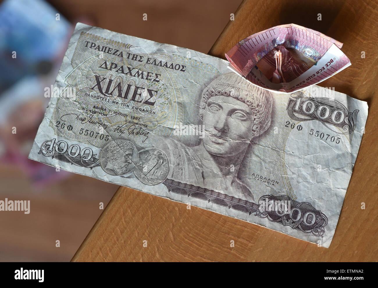 Berlin, Germany. 14th June, 2015. ILLUSTRATION - a ten euro bill which has been folded into a boat lies on a 1000 Greek drachma bill in Berlin, Germany, 14 June 2015. Photo: Jens Kalaene/dpa/Alamy Live News Stock Photo