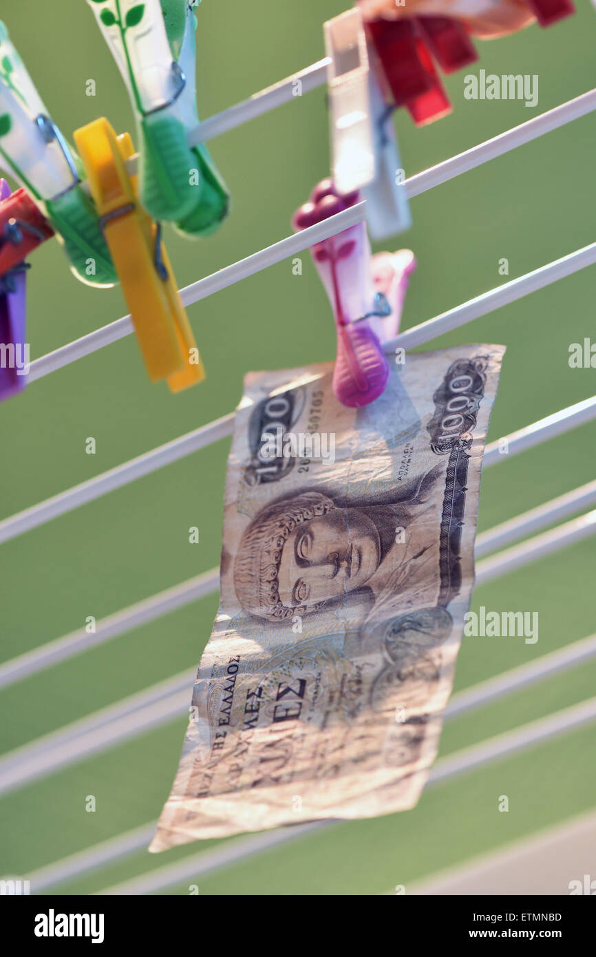 Berlin, Germany. 14th June, 2015. ILLUSTRATION - A 1000 Greek drachma bill hangs from a clothes line in Berlin, Germany, 14 June 2015. Photo: Jens Kalaene/dpa/Alamy Live News Stock Photo