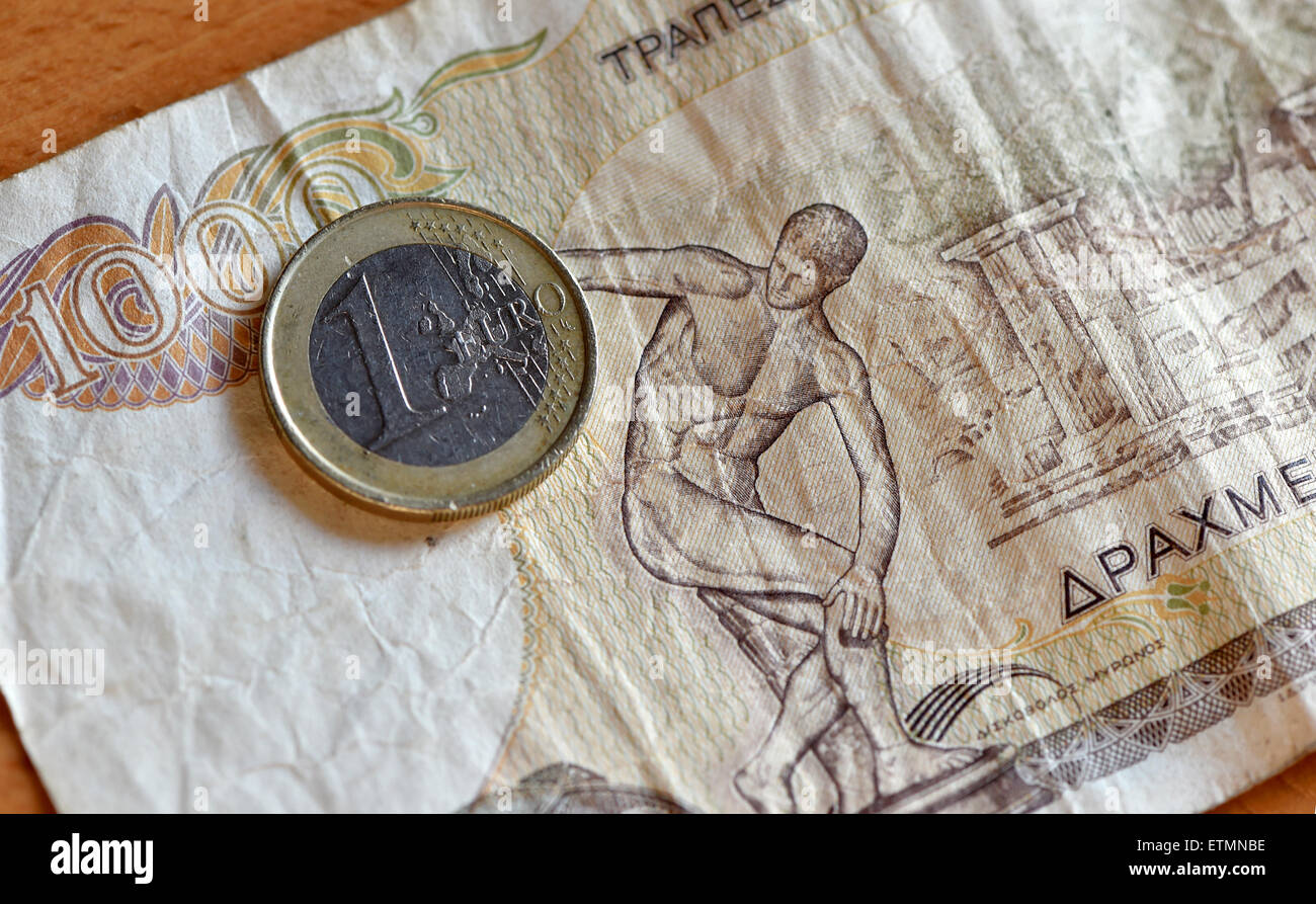 Berlin, Germany. 14th June, 2015. ILLUSTRATION - A euro coin is placed on a 1000 Greek drachma bill in Berlin, Germany, 14 June 2015. Photo: Jens Kalaene/dpa/Alamy Live News Stock Photo