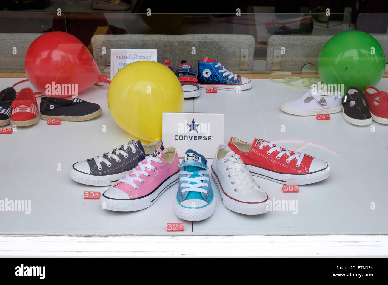 9d1b2b7a94d6 Children s Converse shoes displayed in a shoe shop window - Stock Image