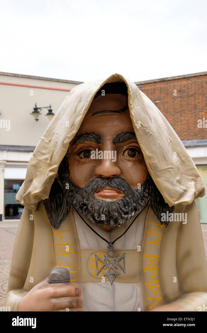 Statue of a bearded Druid with hood pulled over his head - Stock Image