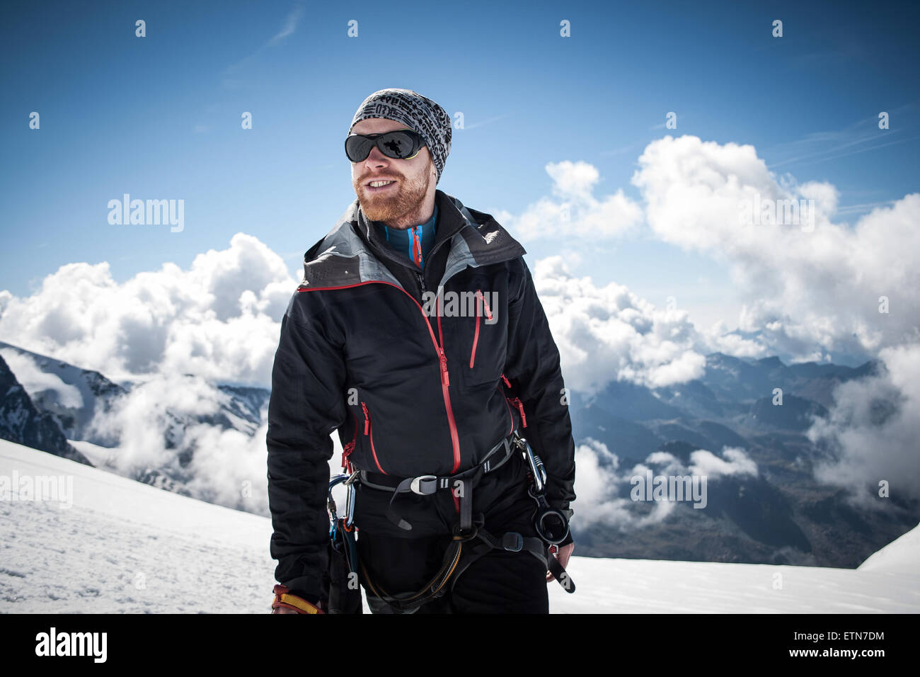 Mid adult man on the summit of Breithornsattel, Zermatt, Switzerland - Stock Image