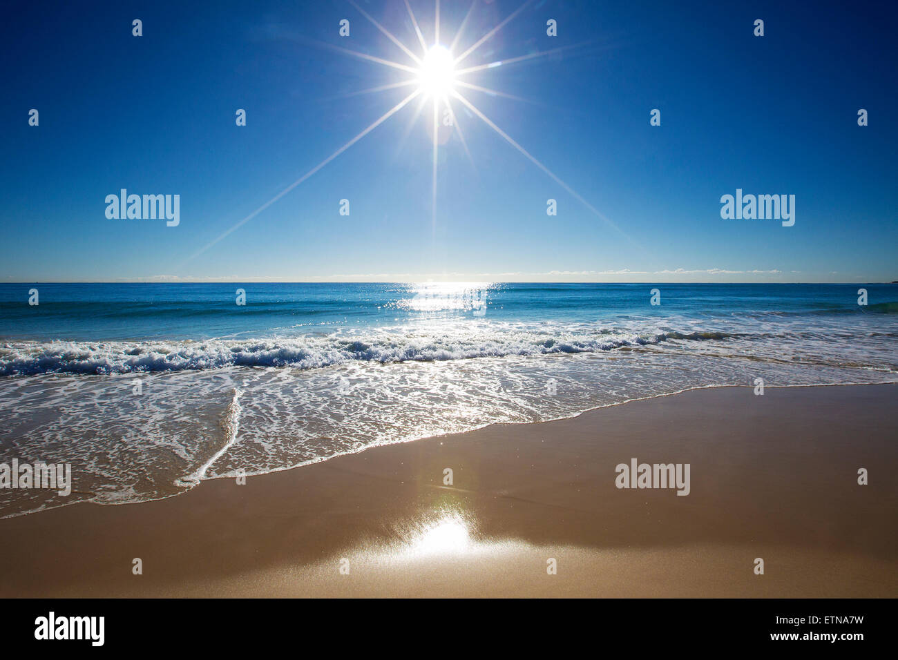 Sunbeam over the sea on Gold Coast, Queensland, Australia - Stock Image