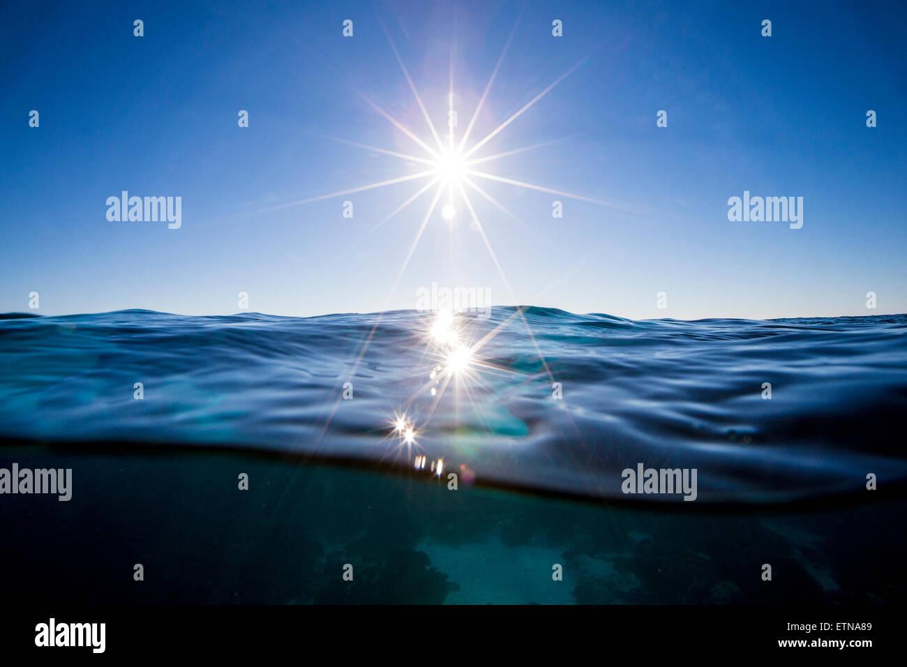 Sun shining over the ocean, Queensland, Australia - Stock Image
