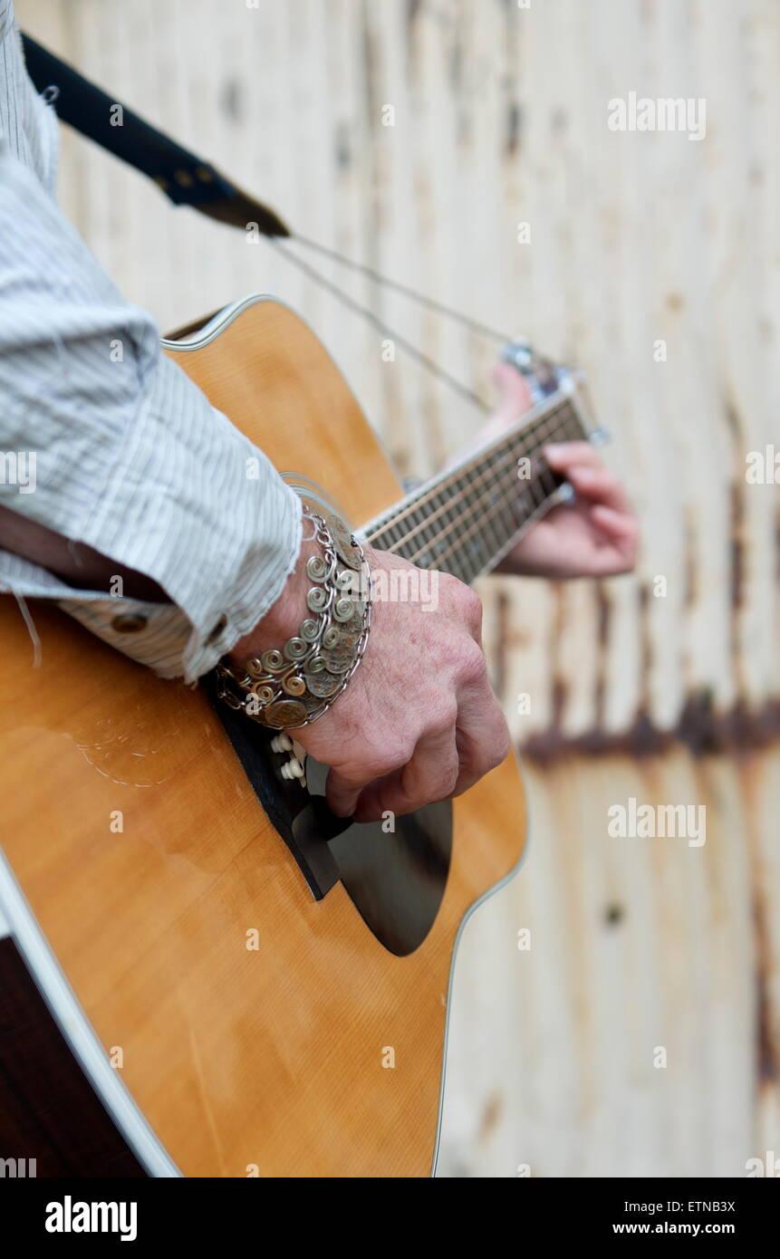 Close-up of  a man playing guitar - Stock Image