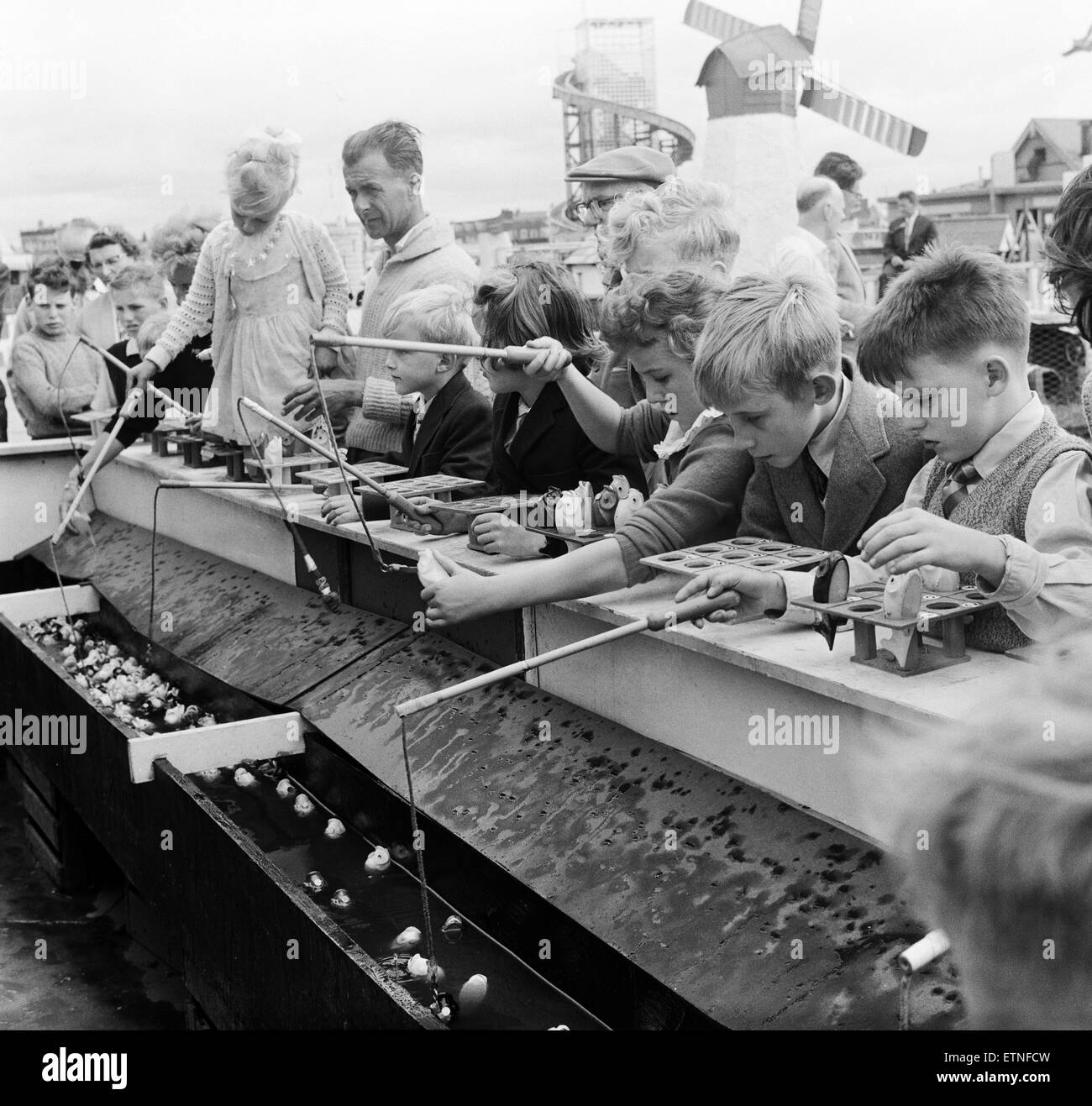 Southport, children fishing for lucky fish at the children's fairground, Merseyside. 5th August 1959. - Stock Image